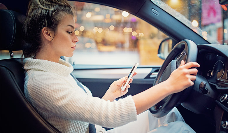 How Automated Safety Systems Lead to Distracted Driving